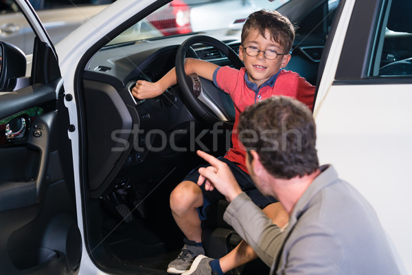 Father and son buying new family car at auto dealership Stock photo © Kzenon