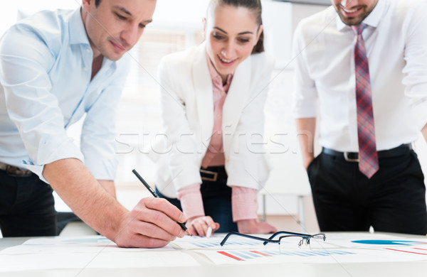 Business people analyzing data - glasses on graph Stock photo © Kzenon