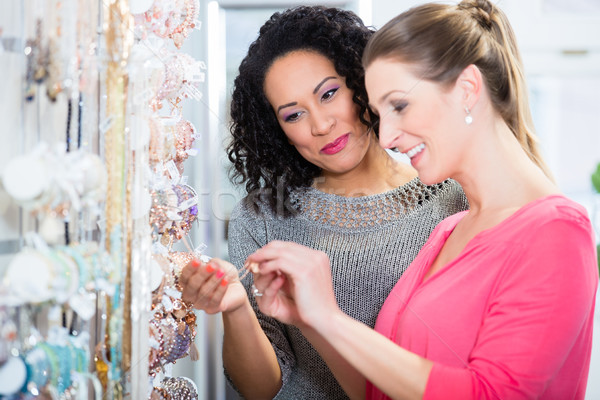 Two friends in jewelry department of shopping mall Stock photo © Kzenon