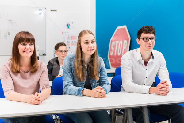 Students in driving lessons listening attentively Stock photo © Kzenon