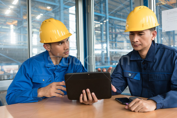 Two Asian workers analyzing information indoors Stock photo © Kzenon