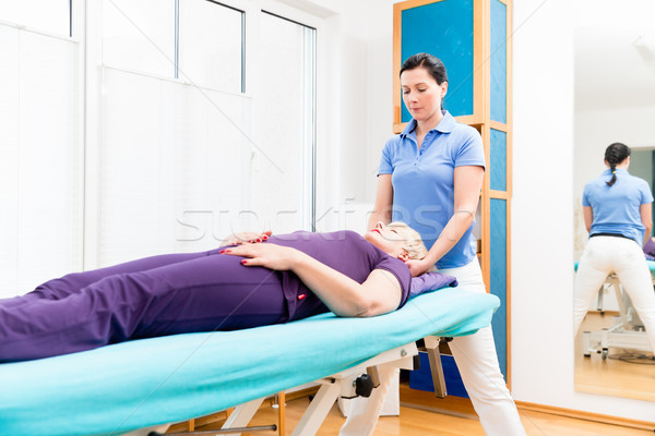 Senior woman visiting physiotherapist for massage Stock photo © Kzenon