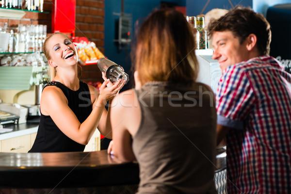 People in club or bar drinking Stock photo © Kzenon