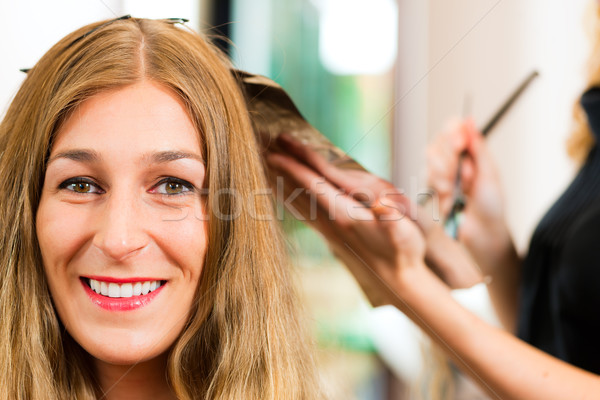 At the hairdresser - woman gets new hair colour Stock photo © Kzenon