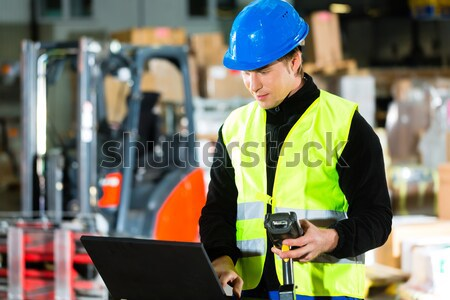 Storeman with scanner at warehouse of forwarding Stock photo © Kzenon
