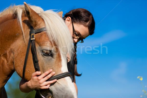 Teenage girl with horse Stock photo © Kzenon