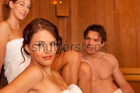 Four friends in sauna of a thermal bath Stock photo © Kzenon