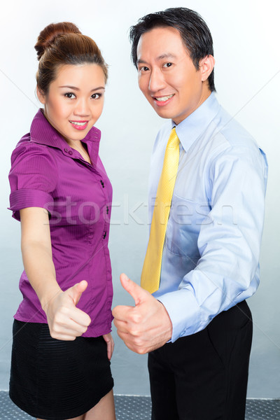 Motivated colleagues in Asian business office Stock photo © Kzenon