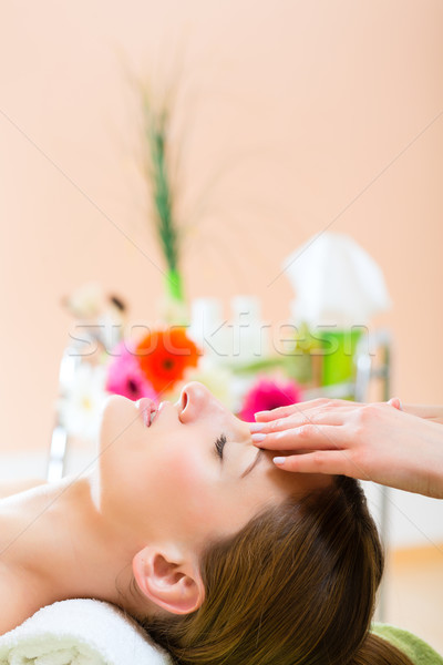 Wellness - woman getting head massage in Spa Stock photo © Kzenon