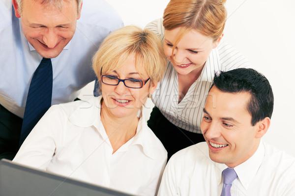 Business team werken computer team vier zakenlieden Stockfoto © Kzenon
