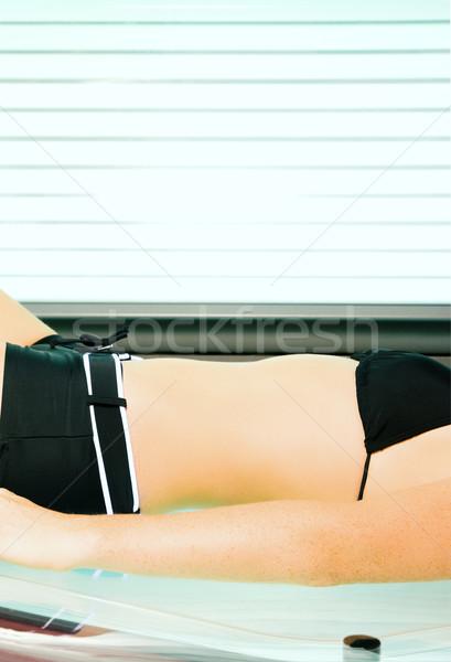 женщину солярий лежак машина Сток-фото © Kzenon
