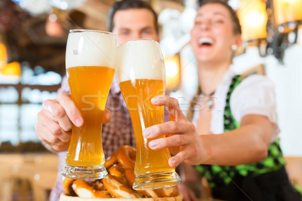 Couple drinking wheat beer in bavarian restaurant Stock photo © Kzenon