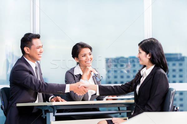 Asian recruitment team hiring candidate Stock photo © Kzenon