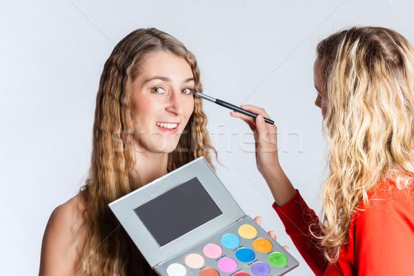 Make-up artist putting make up on woman  Stock photo © Kzenon