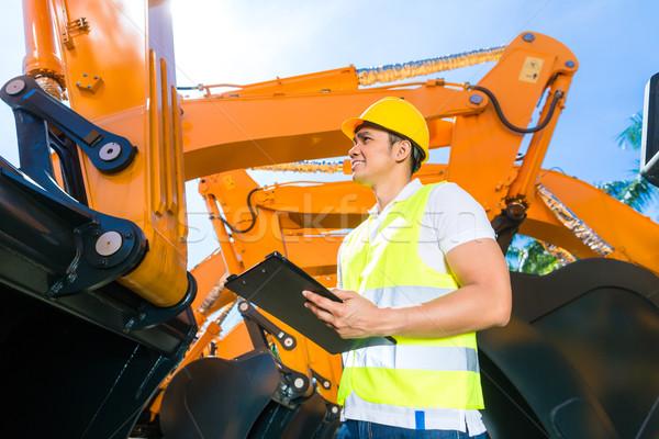 Asian engineer controlling shovel excavator  Stock photo © Kzenon