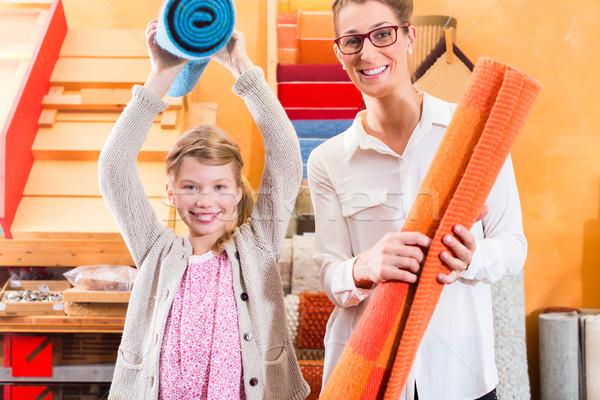 Family Designer buying rug or carpeting Stock photo © Kzenon