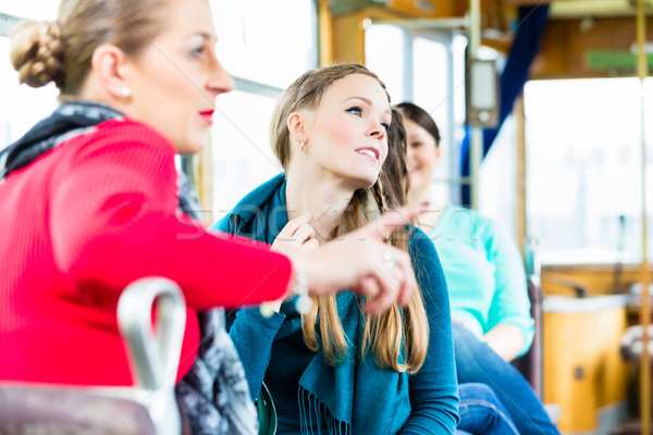 Group of people commuting in tram or cable car Stock photo © Kzenon