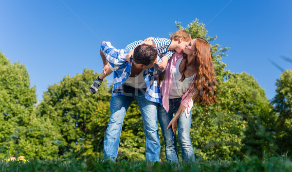 Apuci hordoz fiú háton hát család Stock fotó © Kzenon