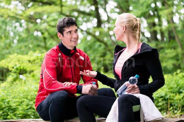 Couple having rest during jogging sport Stock photo © Kzenon