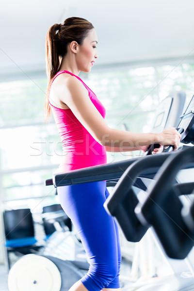 Lány edzés futópad nő sport test Stock fotó © Kzenon