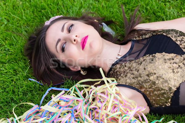 Bêbado menina gramado festa mulher grama Foto stock © Kzenon