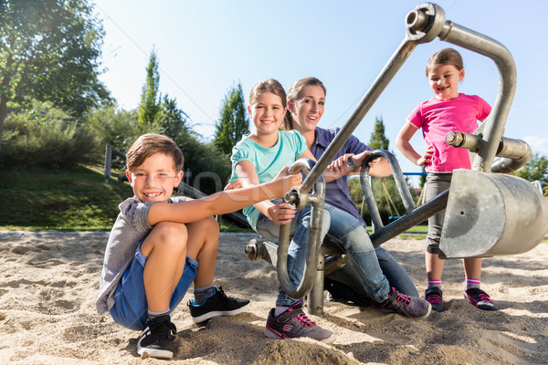 Mother and kids in sandbox playing with digger  Stock photo © Kzenon
