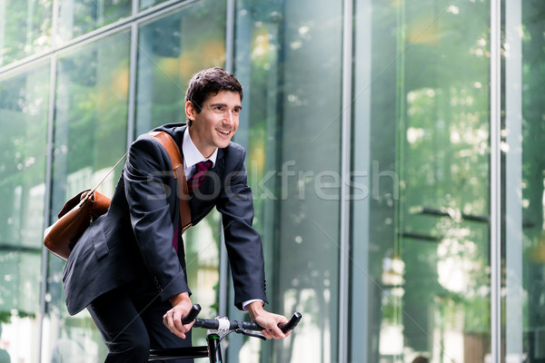 Cheerful young employee riding an utility bicycle in Berlin Stock photo © Kzenon