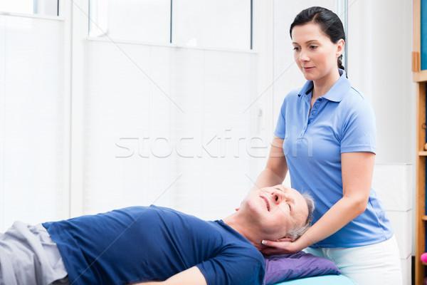 Senior man massage ouderen ontspannen Maakt een reservekopie Stockfoto © Kzenon
