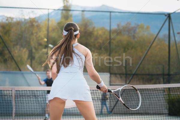 женщину ждет возврат играет теннис партнера Сток-фото © Kzenon