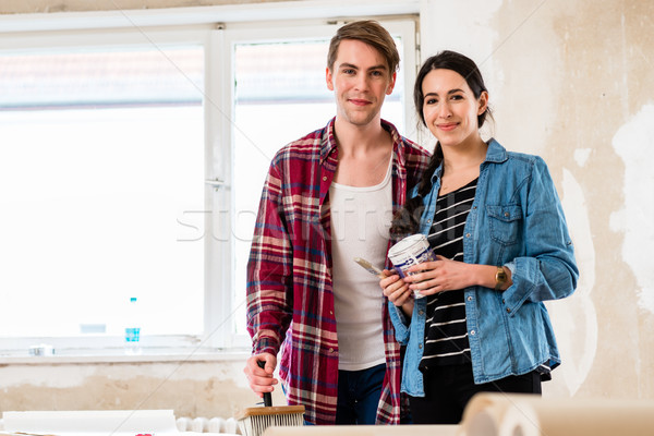 Portrait of a happy young couple holding tools for home remodeling Stock photo © Kzenon