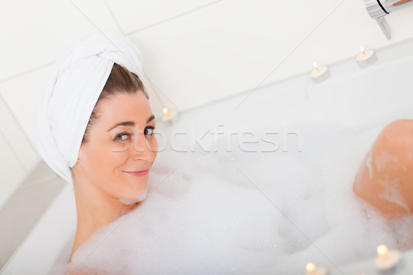 Woman takes bubble foam bath Stock photo © Kzenon