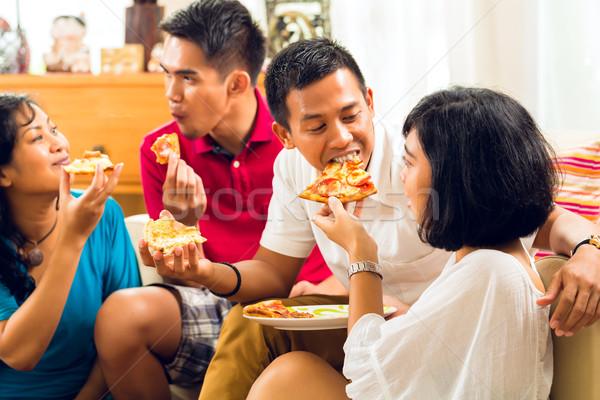 Asian personnes manger pizza fête dîner Photo stock © Kzenon
