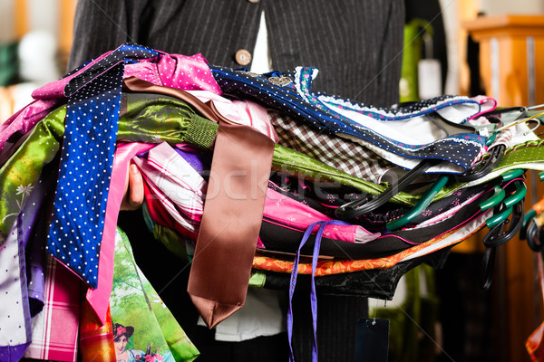 Man is buying Tracht or dirndl in a shop Stock photo © Kzenon
