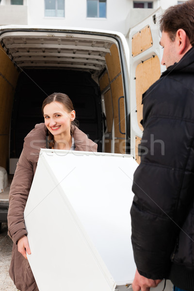 Young couple loading a moving truck Stock photo © Kzenon