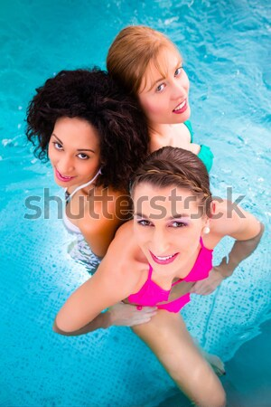 Wellness - mature and young woman in swimming pool Stock photo © Kzenon