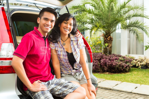 Asian couple is happy in front the car Stock photo © Kzenon