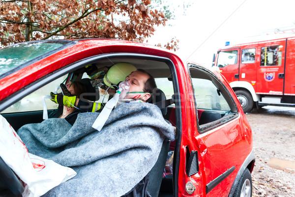 Accident - Fire brigade rescues Victim of a car Stock photo © Kzenon