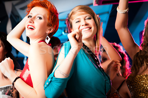 Women in club or disco dancing Stock photo © Kzenon