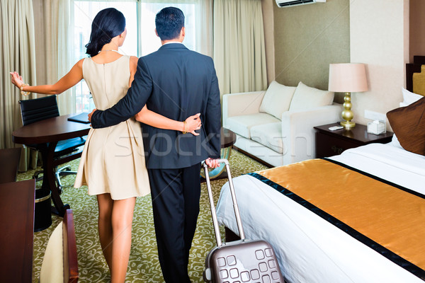 couple arriving to hotel room Stock photo © Kzenon