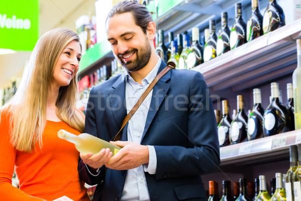 Couple selecting wine in supermarket Stock photo © Kzenon