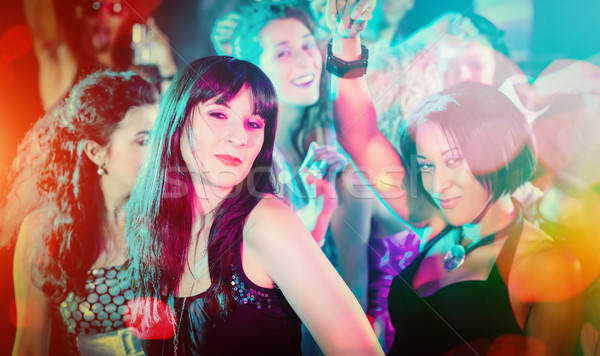 Crowd dancing in club having party Stock photo © Kzenon