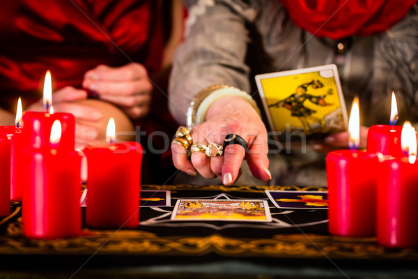 Tarot kartları müşteri mumlar kitap Stok fotoğraf © Kzenon