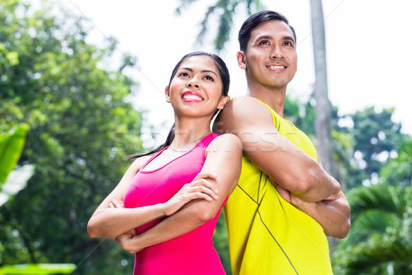 Asian vrouw man jogging opleiding permanente Stockfoto © Kzenon