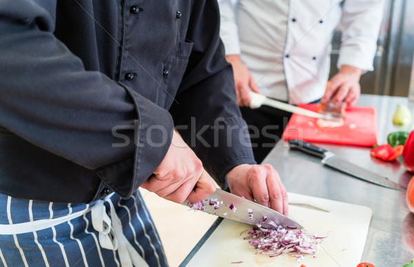 Crop of chefs cutting onions and other food ingredients Stock photo © Kzenon