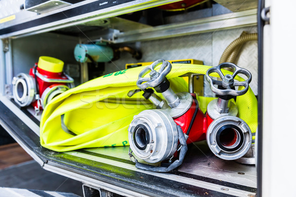 Hoses in vehicle of german fire brigade Stock photo © Kzenon