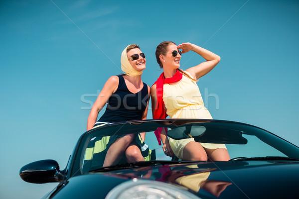 Woman having summer trip in convertible car  Stock photo © Kzenon