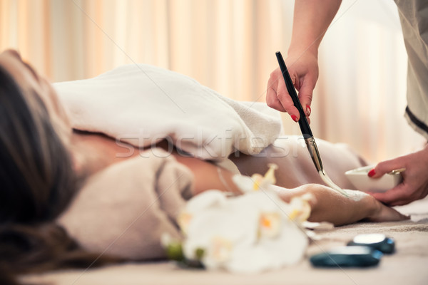 Stock photo: Woman relaxing at beauty center during treatment for skin rejuve