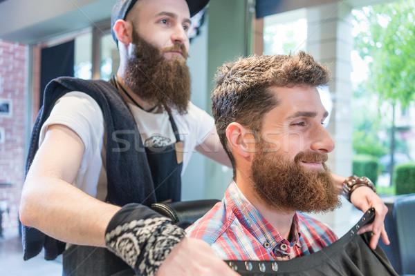 Przystojny młodych brodaty człowiek uśmiechnięty modny Zdjęcia stock © Kzenon