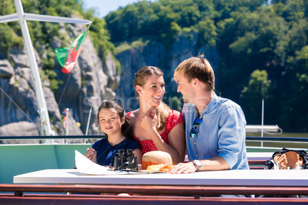 Family on river cruise looking at mountains from ship deck Stock photo © Kzenon