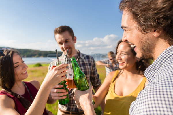 Group of friends at BBQ party toasting with drinks  Stock photo © Kzenon